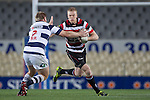 Baden Kerr tries to fend off Tom McCartney. Grant Henson runs out in his 100th game for the Counties Manukau Steelers. ITM Cup Round 7 rugby game between Auckland and Counties Manukau, played at Eden Park, Auckland on Thursday August 11th..Auckland won 25 - 22.