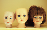 Three doll heads