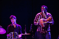 Miles Arntzen plays the drums, while Marcus Farrar plays the shekere and sings backing vocals during the Antibalas performance at Union Transfer in Philadelphia on December 13, 2012.