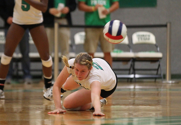 Denton, TX - OCTOBER 19: May Allen #2 of the University of North Texas Mean Green Volleyball dives to save the ball against the Florida International University at University of North Texas Volleyball Complex in Denton on October 19, 2012 in Denton, Texas. (Photo by Rick Yeatts)