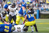 Newark, DE - October 29, 2016: Towson Tigers defensive end Kanyia Anderson (99) and Towson Tigers defensive lineman Max Tejada (93) tackles Delaware Fightin Blue Hens running back Jalen Randolph (33) during game between Towson and Delware at  Delaware Stadium in Newark, DE.  (Photo by Elliott Brown/Media Images International)