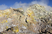 Fumaroles with sulfur deposits on the flank of Bocca Nuova Crater, Mount Etna Volcano, Sicily, Italy.