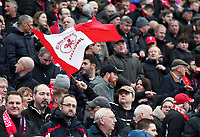 A Liverpool fan waves a &quot;You'll Never Walk Alone&quot; flag as he waits for kick-off<br /> <br /> Photographer Rich Linley/CameraSport<br /> <br /> The Premier League - Liverpool v Burnley - Sunday 12 March 2017 - Anfield - Liverpool<br /> <br /> World Copyright &copy; 2017 CameraSport. All rights reserved. 43 Linden Ave. Countesthorpe. Leicester. England. LE8 5PG - Tel: +44 (0) 116 277 4147 - admin@camerasport.com - www.camerasport.com