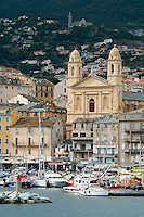 Bastia, Corsica, France, September 2012. A look down from the citadel onto the city center and the marina. The town of Bastia is the first city that most people see after arriving on the island by ferry. Corsica is a wildly beautiful French island, scented with myrtle and possessing one of the most diverse landscapes in Europe, from crescent bays with white-sand beaches to montane forests sheltering rugged granite peaks, with miles of untouched coastline, sun-splashed mountain villages. Photo by Frits Meyst/Adventure4ever.com