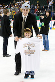 Luke McManus (Duluth - 21) with one of Derek Plante's sons. - The University of Minnesota-Duluth Bulldogs celebrated their 2011 D1 National Championship win on Saturday, April 9, 2011, at the Xcel Energy Center in St. Paul, Minnesota.