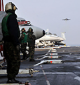 Aviation Boatswain's Mates (Handling) await the arrival of a Super Hornet Monday, November 29, 2010 on the flight deck aboard the aircraft carrier USS George Washington (CVN 73). George Washington is in the waters west of the Korean peninsula preparing for a training exercise with the Republic of Korea Navy..Mandatory Credit: David A. Cox - US Navy via CNP