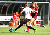 WINSTON-SALEM, NORTH CAROLINA - August 30, 2013:<br />  Rachel Melhado (24) of Louisville University pushes the ball away from Ashley Meier (15) of Virginia Tech during a match at the Wake Forest Invitational tournament at Wake Forest University on August 30. The game ended in a 1-1 tie.