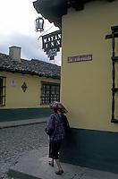 Maya woman turning a street corner in Chichicastenango, Guatemala