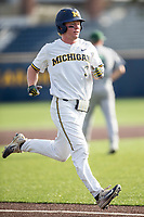 Michigan Wolverines outfielder Miles Lewis (3) runs to cross the plate during the NCAA baseball game against the Eastern Michigan Eagles on May 16, 2017 at Ray Fisher Stadium in Ann Arbor, Michigan. Michigan defeated Eastern Michigan 12-4. (Andrew Woolley/Four Seam Images)
