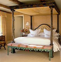 The hand-painted and gilded tester bed in the master bedroom was made by C. Robert Huggins