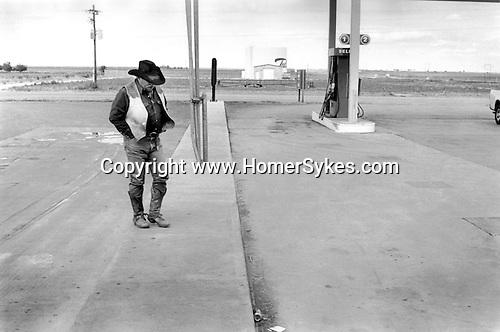 Denton Texas USA 1999. A lone cowboy at a petrol station..