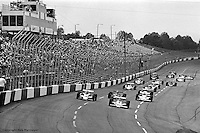 HAMPTON, GA - APRIL 22:Johnny rutherford (#4 McLaren M24B/Cosworth TC) and Gordon Johncock (#20 Penske PC6/Cosworth TC) lead the field from the front row at the start of the second race of the Gould Twin Dixie 125 event on April 22, 1979, at Atlanta International Raceway near Hampton, Georgia.