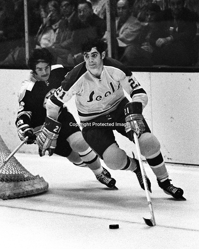 Seals vs. Boston , Derek Sanderson chasing Seal's   #21 Ron Stackhouse. (photo/Ron Riesterer 1971)              ..