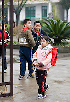 Boys watch girl leaving the playground of a primary school, in Fuli. China has a one child policy to limit population.