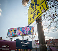 "The ""Keep Calm Billboard"" in Sunnyside, Queens in New York is seen on Friday, January 16, 2015. The billboard by the artist Margeaux Walter displays an assortment of reworked versions of the ubiquitous ""Keep Calm and Carry On"" British Stationary Office slogan from WWII. The billboard is the seventh campaign of the 14X48 organization which repurposes vacant billboards turning them into public art galleries.   (© Richard B. Levine)"