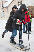 Young Women Sledging,  Modern Kicksled in Kolkja Kelk, Tartu County, Estonia