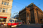 A tram rounds the corner by  Prague's historic National Theatre, constructed in 1883, considered the prime stage in the Czech Republic, Europe
