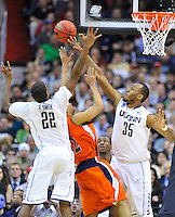 Cameron Ayers of the Bison has a tough time with the Huskies' defense. Connecticut defeated Bucknell 81-52 during the NCAA tournament at the Verizon Center in Washington, D.C. on Thursday, March 17, 2011. Alan P. Santos/DC Sports Box