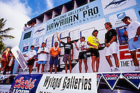 The winner of the 1991 Wyland Galleries Hawaiian Pro Tom Curren (USA) won the stage with the other finalists Johnny Boy Gomes (HAW), Tom Carroll (AUS) and Martin Potter (GB). Also on the stage is the artist Wyland (HAW). Circa 1991 Photo: joliphotos.com