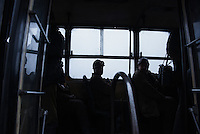Ukrainian coal miners wait in a bus before going underground to help search for bodies of colleagues and clear up debris following an explosion at the Zasyadko mine in Donetsk, Ukraine, Wednesday, March 4, 2015
