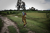 A woman is seen walking past barren farmlands in village Rajagaon in Block Machreta of Uttar Pradesh, India. The 4 month annual rainfall is crucial to summer sown crops as 60% of the farmlands are rainfed. North India experienced scanty rainfall in late june to july. Till August, rain in India has been 26% below 5 year average. Late rains moist the fields but it is not enough for rice, sugarcane, oilseeds and pulses. Late rains also damage the alternate crops that need less water.