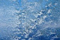 &quot;WINDOW CRYSTALS-4&quot;<br /> <br /> Ice crystals form on the surface of a body of water creating what appears to be clouds on a blue sky.