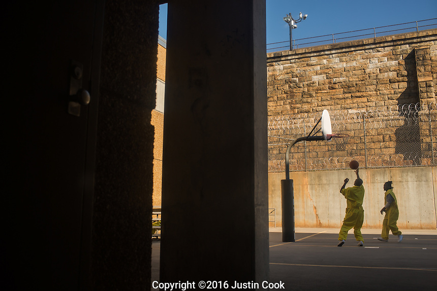 Inmates play basketball in the yard at Central Prison in Raleigh, NC on Thursday, November 17, 2016. (Justin Cook)