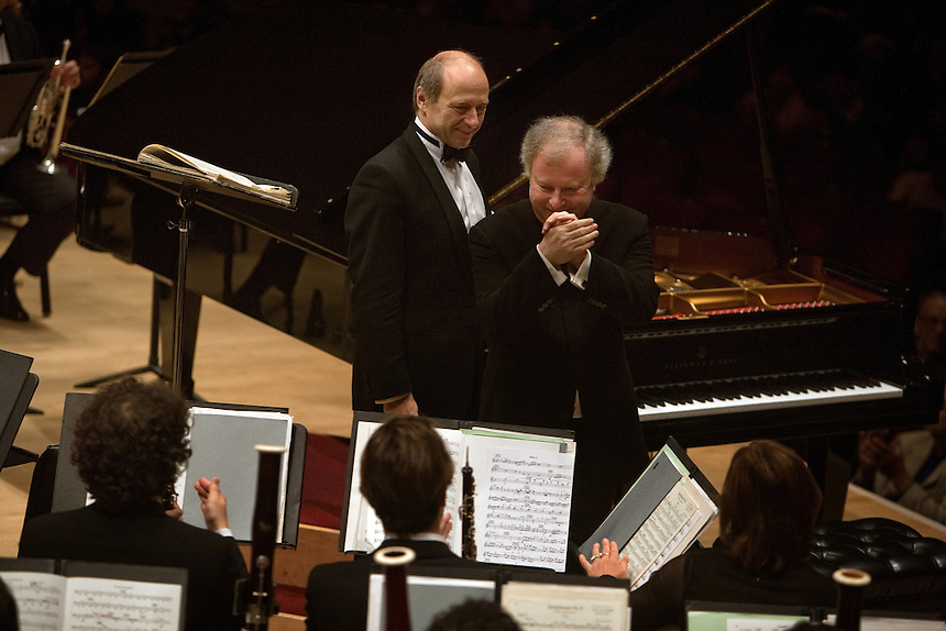 Music Director and Conductor Ivan Fischer and pianist Andras Schiff thank the Budapest Festival Orchestra after their performance at Carnegie Hall in Manhattan, NY on October 29, 2011.