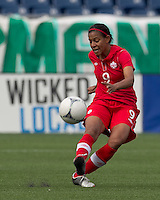 Canadian defender  Candace Chapman (9) passes the ball. In an international friendly, Canada defeated Brasil, 2-1, at Gillette Stadium on March 24, 2012.