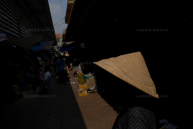 Vietnamese women walk to the market in Ho Chi Minh City, Vietnam.