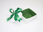 Open gift box with green grass lining.