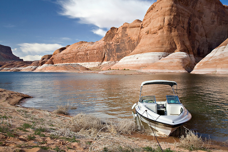 A boat sits along the shores of Lake Powell near Oak Canyon