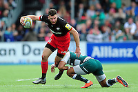 Duncan Taylor of Saracens is tackled in possession. Aviva Premiership semi final, between Saracens and Leicester Tigers on May 21, 2016 at Allianz Park in London, England. Photo by: Patrick Khachfe / JMP
