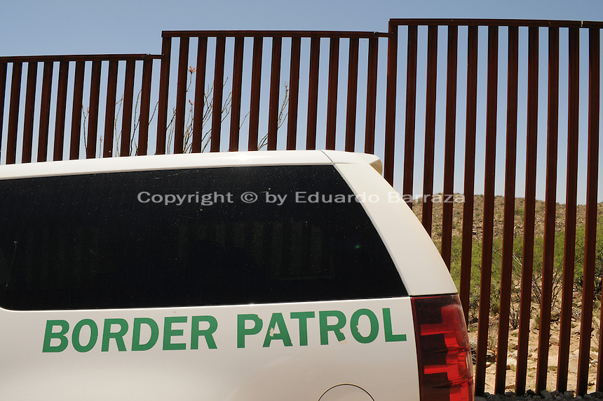 Sasabe, Arizona – A Border Patrol vehicle parked next to the border fence near Sasabe, Arizona. The fence ends in this section of the international border. This area is located near the Sasabe Port of Entry, a border-crossing station located in southern Arizona, and about 70 miles from the City of Tucson. Sasabe is one of the most isolated ports along the 2,000-mile U.S.-Mexico border, and it connects the towns of Sasabe, Arizona and El Sasabe, Sonora (Mexico). The border-crossing station is located in one of the busiest human and drug smuggling corridors of the U.S.-Mexico border. U.S. Customs Border Protection (CBP) transported journalists to a remote area where they walked through a 1.3 miles trail during a two-day event organized by the Tucson Sector Border Patrol. The event brought national and international journalists to the Arizona desert to become acquainted with the dynamics of this area. Photo by Eduardo Barraza © 2012