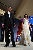 Washington, DC - January 20, 2009 -- United States President Barack Obama and his wife First Lady Michelle Obama arrive on stage during MTV & ServiceNation: Live From The Youth Inaugural Ball at the Hilton Washington on January 20, 2009 in Washington, DC. President Barack Obama was sworn in as the 44th President of the United States today, becoming the first African-American to be elected President of the US. .Credit: Mark Wilson - Pool via CNP