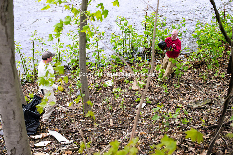 Waterbury, CT- 06 May 2017-050617CM07-  Kenny Curran, chairman of the Greenway Advisory Committee, left, and Will Wesson, vice president at Wesson Energy clean up along the Naugatuck River on Saturday. Volunteers spent the morning cleaning up the river along the section of Municipal Road.   Christopher Massa Republican-American