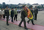 Goose stepping guards carry a donated floral weath to Ho Chi Ming's marble tomb on Dien Bien Phu Street in Hanoi, North Vietnam.  (Jim Bryant Photo).......