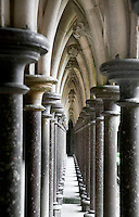 Double row of frail looking arches on the garden side of the Cloister, 40 metres above the rock, linked to the Abbey Church, the Refectory and the Dormitory, the Merveille (Marvel), 13th century, thanks to a donation by the king of France, Philip Augustus who offered Abbot Jourdain, a grant for the construction of a new Gothic-style architectural set, Le Mont Saint Michel, Manche, Basse Normandie, France. Picture by Manuel Cohen