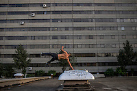 A young man practices Parkour, a sport using the urban landscape as an obstacle course.