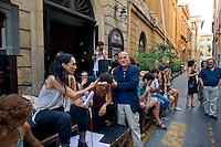 Roma 11 Agosto 2014.<br /> Gli occupanti del Teatro Valle nel giorno della riconsegna dello stabile al Comune di Roma.<br /> La Fondazione Teatro Valle Bene Comune, i suoi artisti e le sue maestranze in assemblea  per la strada davanti al teatro. Ilenia Caleo, attrice, portavoce del Teatro Valle Occupato (L) con Marino Sinibaldi  presidente del Teatro di Roma (C)<br /> Rome August 11, 2014. <br /> The occupants of the Teatro Valle in the day of delivery of the building to the City of Rome. <br /> The Fondazione Teatro Valle Common Good, its artists and its workers in  assembly  in the street in front of the theater. Ilenia Caleo, actress, spokesperson for the Teatro Valle Occupied (L) with Marino Sinibaldi (C) , president of the Theatre of Rome.