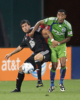Santino Quaranta #25 of D.C. United tussles with James Riley #7 of Seattle Sounders FC during an MLS match at RFK Stadium on July 15 2010, in Washington DC.Seattle won 1-0.