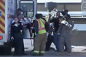 Fort Hood, TX - November 5, 2009 -- Emergency personnel carry a victim to an ambulance in the deadly shooting on Fort Hood, Texas, Thursday, November 5, 2009. Thirteen people were killed and 30 others were injured in the rampage. .Mandatory Credit: DoD Video Screengrab via CNP