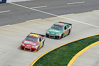 30 March - 1 April, 2012, Martinsville, Virginia USA.Dale Earnhardt Jr. takes the lead from Jeff Gordon.(c)2012, Scott LePage.LAT Photo USA