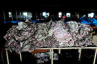 Burned clothing lies in the factory after the blaze. At least 112 people died, and more than 100 were injured at a fire at the Tazreen Fashions textile factory in Dhaka. Bangladesh's garment industry has a notoriously bad fire safety record; if the right precautions had been taken, the fire could have been prevented.