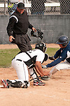 Vale catcher Derrek Rodriguez is in position to apply the tag on a sliding Matt York on April 28, 2011 at Cammann Field.