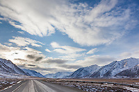 Trans Alaska oil pipeline traverses the snowy arctic tundra along the James Dalton Highway in the Brooks range mountains of Alaska.
