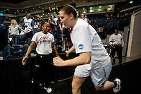NORFOLK, VA--Senior Sarah Boothe gives five to freshman Jasmine Camp as she takes to the court against Hampton University at the Ted Constant Convocation Center at Old Dominion University in Norfolk, VA in the first round of the 2012 NCAA Championships. The Cardinal advanced with a 73-51 win to play West Virginia on Monday, March 19.