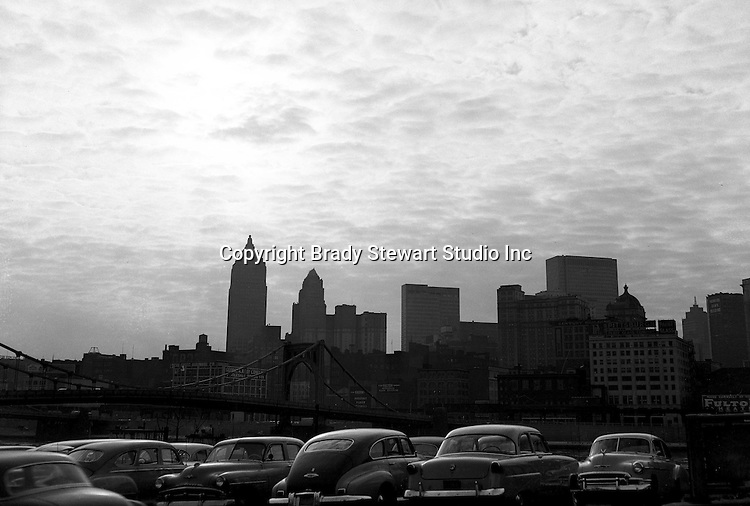 Pittsburgh PA:  View of the Pittsburgh Skyline at dusk from a North Side parking lot - 1956