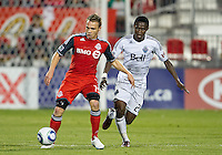 Toronto FC midfielder Matt Stinson #15 and Vancouver Whitecaps FC midfielder Gershon Koffie #28 in action during an MLS game between the Vancouver Whitecaps FC and the Toronto FC at BMO Field in Toronto on June 29, 2011..Toronto FC won 1-0..