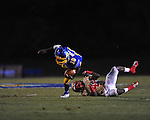 Oxford High's Nick Brown (18) breaks the tackle of Lafayette High's Brandon Mack (4) at Bobby Holcomb Field in Oxford, Miss. on Thursday, August 30, 2012. Oxford High won 19-0.